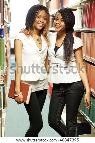 Teenage girls in the library - stock photo