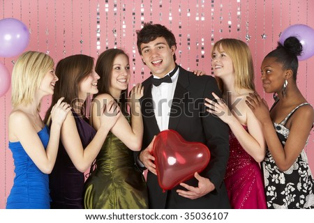 Teenage Girls Looking At Attractive Boy - stock photo