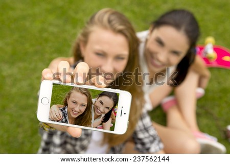 Teenage girls making a selfie  - stock photo