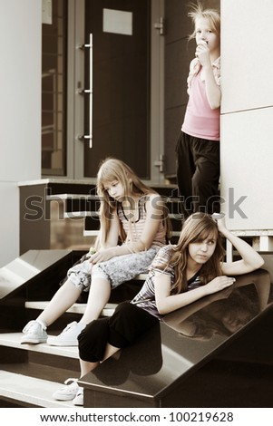 Teenage girls on the steps - stock photo
