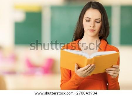 Teenage Girls, Teenager, Reading. - stock photo