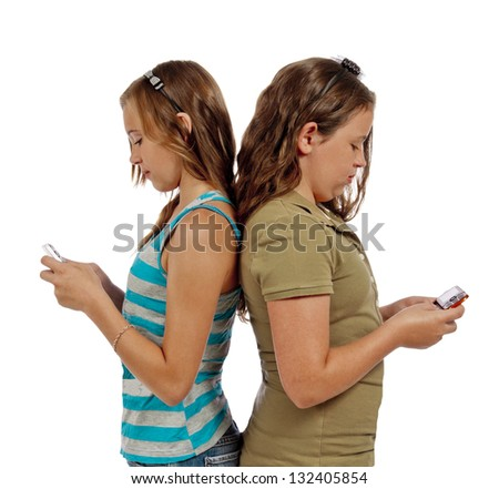 Teenage Girls Text Messaging Instead Of Talking To Each Other/ Isolated On White Background - stock photo