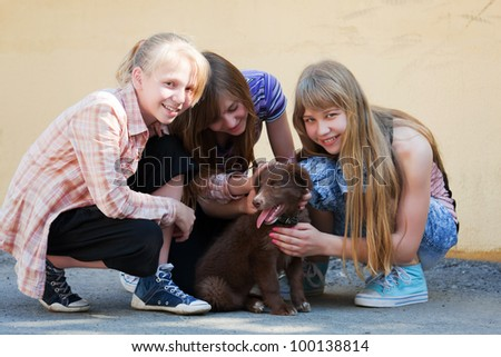 Teenage girls with a puppy - stock photo