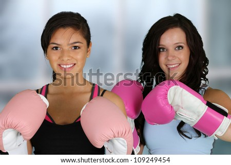 Teenage girls working out in the gym - stock photo