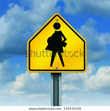 Teenage pregnancy and human reproductive biology education contraceptive usage social concept as a symbol of  teens and unplanned pregnant school students with a yellow school crossing sign. - stock photo