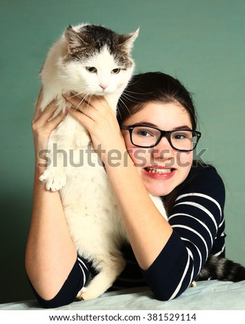 teenage pretty girl in short sight glasses with siberian big cat close up portrait  - stock photo
