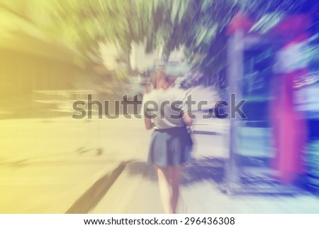 teenage rush walking on footpath in motion blur  - stock photo