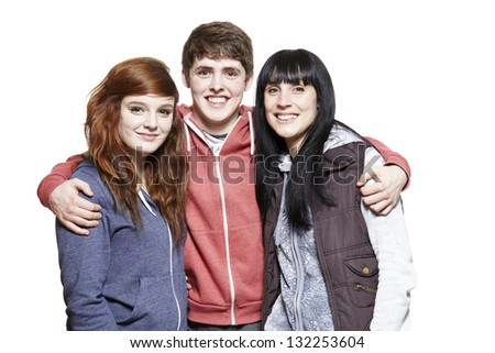 Teenage siblings smiling on white background - stock photo