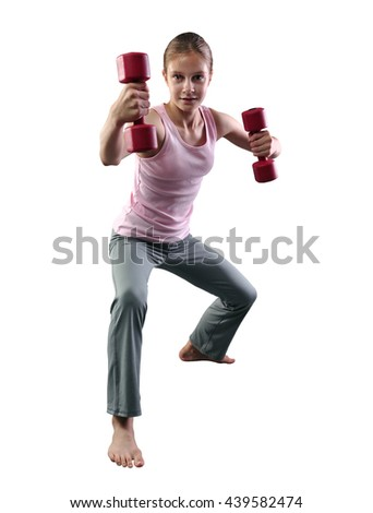 Teenage sportive girl is doing exercises with dumbbells to develop muscles on white background.  Sporty childhood. Full length portrait of teenager child exercising with weights. - stock photo