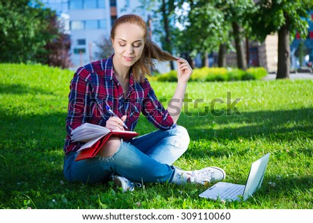 teenage student or school girl sitting in summer park - stock photo