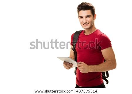 Teenage student posing with tablet.