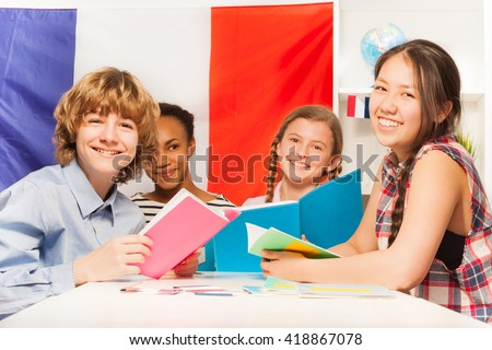 Teenage students learning French at the classroom - stock photo