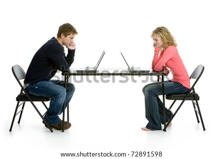 Teenage students using laptops on white background in studio - stock photo