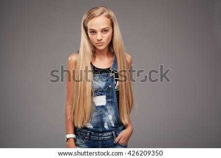 Teenage stylish blonde with long beautiful hair - stock photo