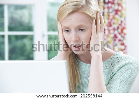 Teenage Victim Of On Line Bullying With Laptop - stock photo
