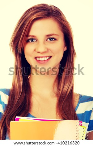 Teenage woman holding a few notebooks - stock photo