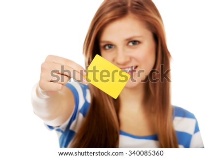 Teenage woman holding empty business card. - stock photo