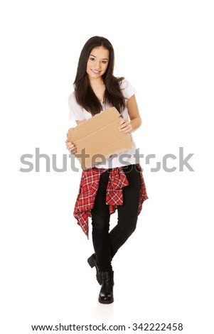 Teenage woman holding empty cardboard. - stock photo
