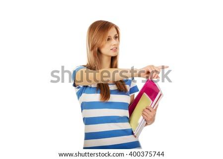 Teenage woman showing copyspace or something - stock photo