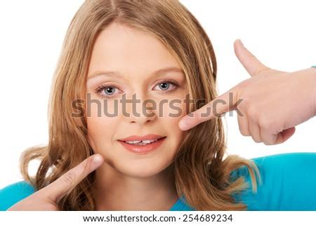 Teenage woman showing her teeth - stock photo
