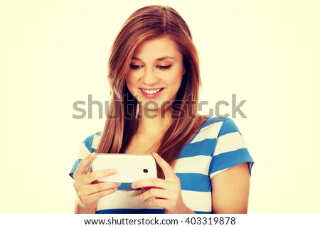 Teenage woman using mobile phone