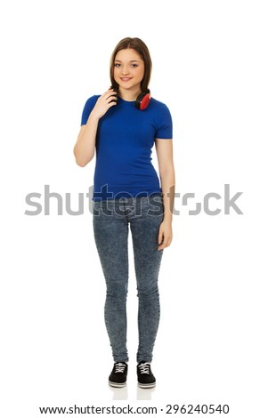 Teenage woman with music headphones. - stock photo