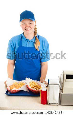 Teenage worker serves meal in a fast food restaurant.  White background - stock photo