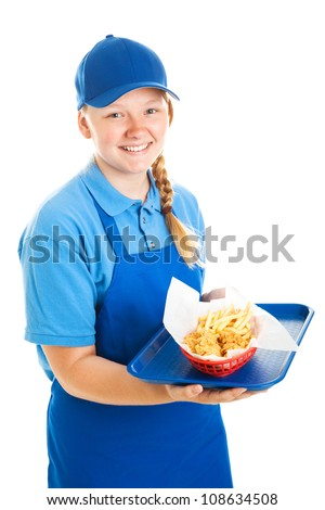 Teenage worker serving a fast food meal.  Isolated on white. - stock photo