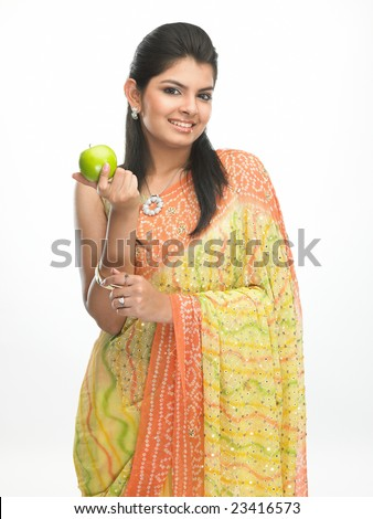 Teenage young indian girl with smiling face having green apple - stock photo