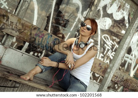 teenager against grunge wall - stock photo