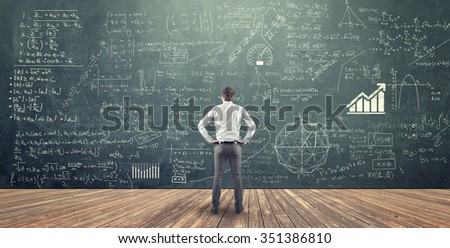 Teenager and blackboard with formula - stock photo