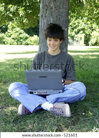 teenager and computer smiling