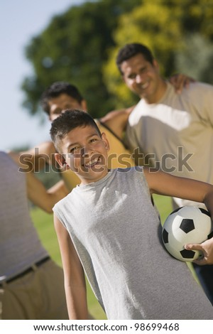 Teenager and Men at the Park - stock photo