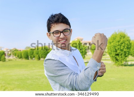 Teenager and sign of victory. - stock photo