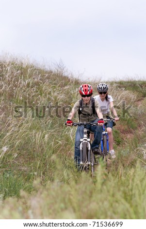 teenager and young woman on the mountain bike
