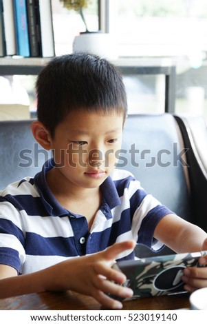 teenager asian nauty boy hold tablet