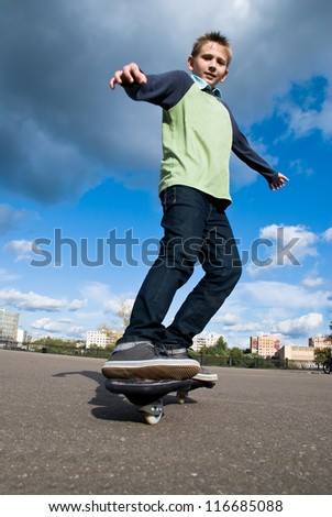 Teenager at the beginning of doing acrobatic stunt on waveboard - stock photo