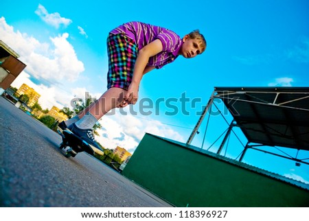 Teenager at the beginning of doing acrobatic stunt on waveboard