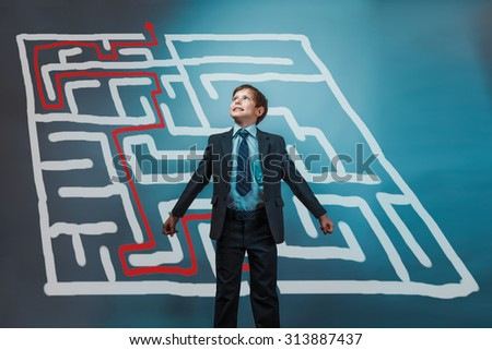Teenager boy plan businessman, his arms looking up the idea of a maze pattern from a crisis solution studio background