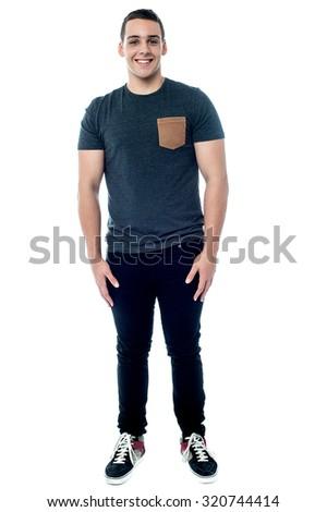 Teenager boy posing, full length portrait. - stock photo