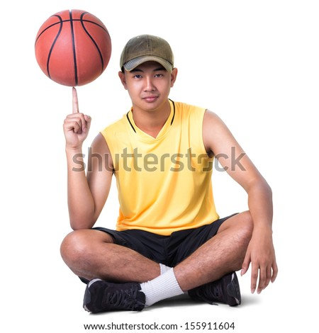 Teenager boy sitting with basketball, Isolated over white with clipping path - stock photo