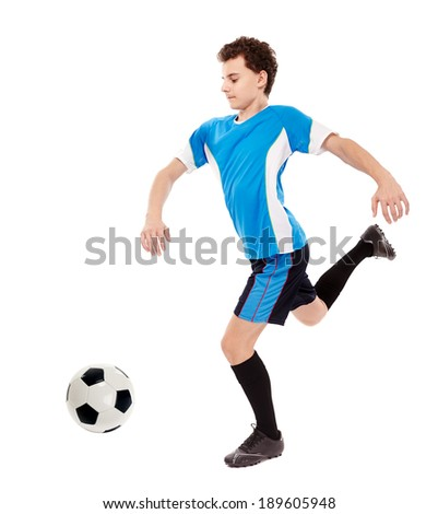 Teenager boy soccer player kicking the ball isolated on white background