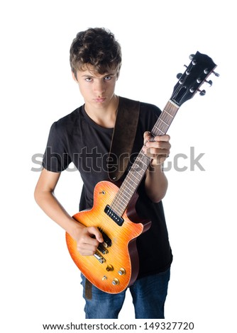 teenager boy standing and playing guitar serious isolated on white