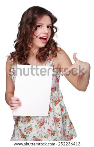 Teenager brunette curly hair girl wearing clothes with floral ornament and showing white blank card