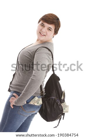 Teenager carrying a backpack with pockets full of money.  Isolated on white with room for your text.  - stock photo