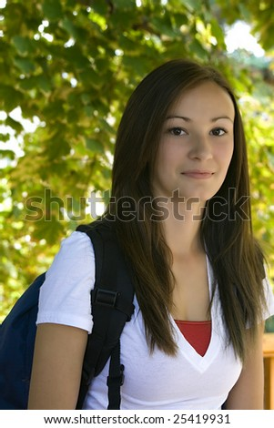 Teenager College Girl with her backpack under a Tree - stock photo