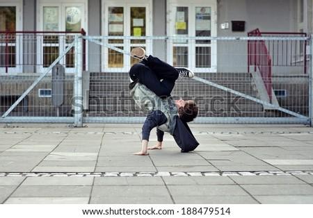 Teenager dancing breakdance on the street - stock photo