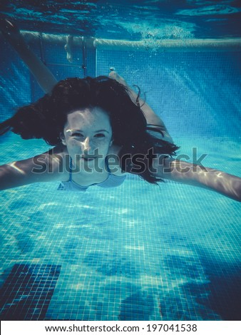 teenager diving into a pool - stock photo