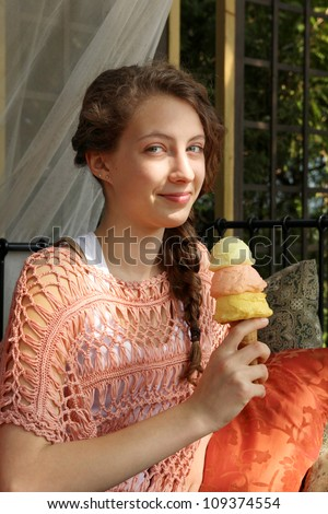 Teenager eating a 3 scoops ice cream cone