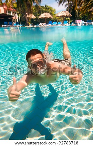 teenager floatsunder water in pool